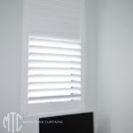 Painted hardwood plantation shutter