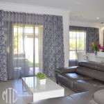Charcoal floral patterned blockout & charcoal sheer double s-fold curtains