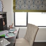 Navy blue paisley Roman blind with olive green contrast border