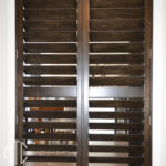 Stained basswood timber shutters