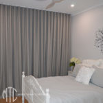 Grey s-fold curtains