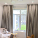Grey s-fold curtains in a nursery