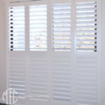 Painted hardwood bifold plantation shutters