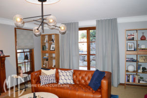 Patterned Roman blind & s-fold curtain