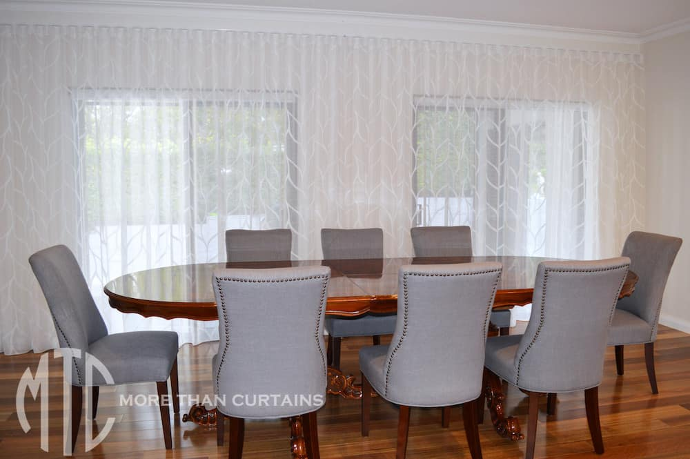 White patterned s-fold sheer curtains