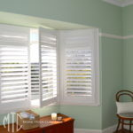 Painted hardwood plantation shutters on a bay window
