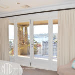 Box pleat curtains on rods