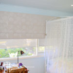 Dandelion patterned Roman blind with coordinating screen roller blinds