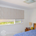 Patterned Roman blind with coordinating screen roller blinds
