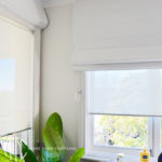 White Roman blinds with coordinating screen roller blinds