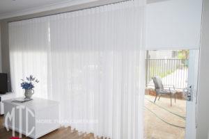 Box Pleat sheer curtains on matt silver rod