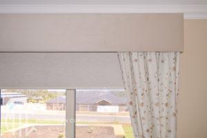 White floral curtains with beige velvet pelmet
