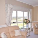 Floral curtains with velvet pelmet & tiebacks