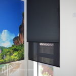 Double black roller blinds