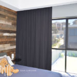 Charcoal s-fold curtain in cavity with screen roller blind