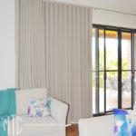 s-fold curtains on a silver rod