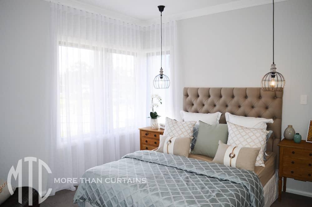 Sheer s-fold white curtain on corner window - Bellriver Homes Calderwood