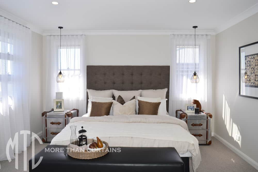S-sold sheer white curtains on silver rods - Bellriver Homes Oran Park