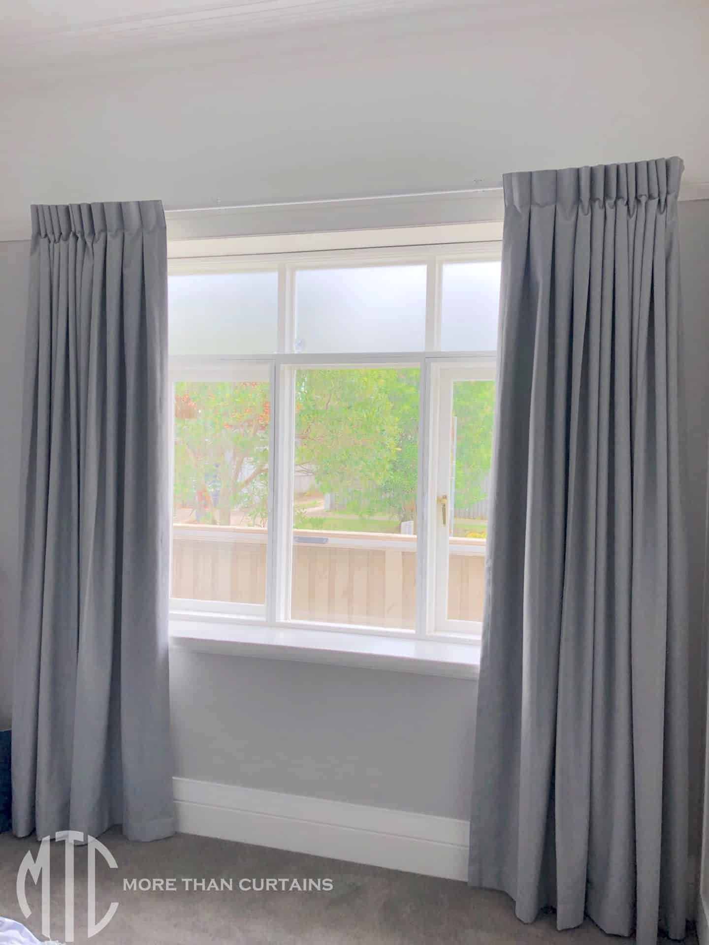 Box pleat grey curtains on a simple track