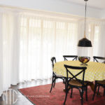 Box pleat white sheer curtains on a bay window