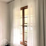 Ivory s-fold sheer curtains with seperate blockout lining on black rods