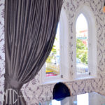 Pinch pleat curtain on black rod