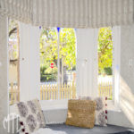 Striped Roman blinds in a bay window