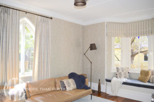 Triple pinch pleat curtains on a bronze rod