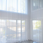Two storey grey sheer curtains