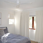 Box pleat white curtains & matching Roman blind