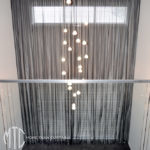 Charcoal s-fold sheer curtains on a double storey window