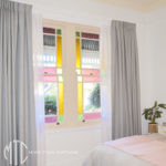 Grey Box pleat blockout curtains with white sheer