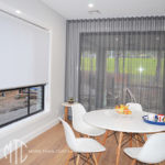 Charcoal s-fold sheer curtains on a corner window with white roller blind - Baulkham Hills 2 2