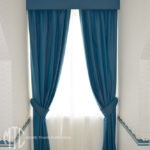Blue blockout curtains & pelmets with white sheers