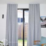 Light grey s-fold curtains