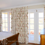 Floral print Euro pleat curtain on a painted timber rod