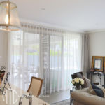 Neutral s-fold sheer curtain with seperate lining on matt silver rod