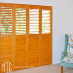 Stained bifold plantation shutters
