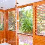 Stained plantation shutters on a corner window
