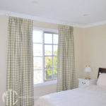 Check Euro pleat curtains on painted timber rod