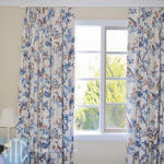Patterned Euro pleat curtains on painted timber rod