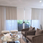 Silver s-fold sheer curtains with blockout roller blinds
