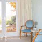 Ticking stripe Euro pleat curtains on painted timber rod