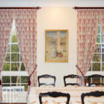 Embroidered goblet pleat curtains on stained timber rods with tassel tiebacks