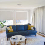 Grey s-fold curtains with coordinating roller blinds