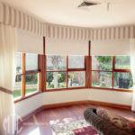 Sheer curtains with tiebacks, pelmet & roller blinds