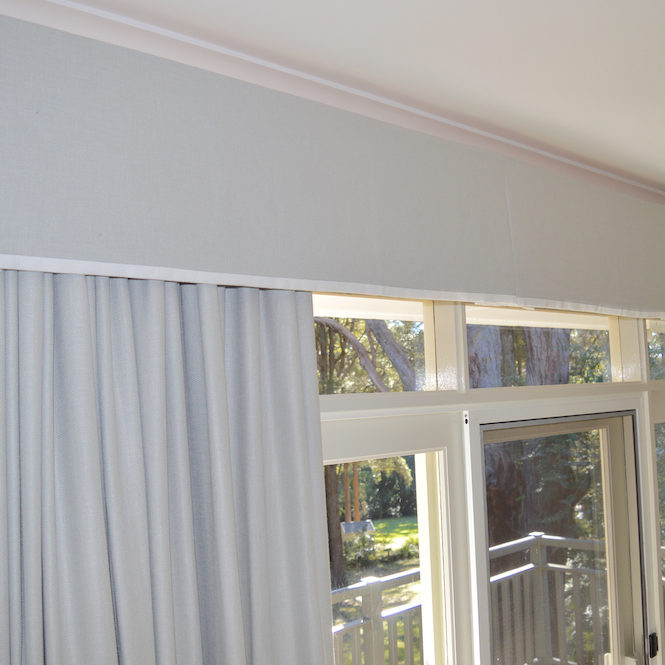 Blockout grey curtains and coordinating box pleat valance with white contrast trim