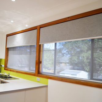 Double grey roller blinds