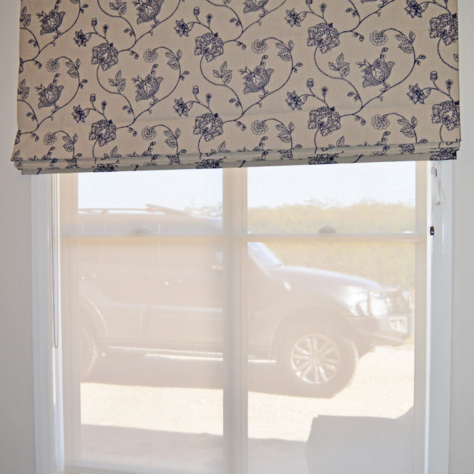 Embroidered floral Roman blind