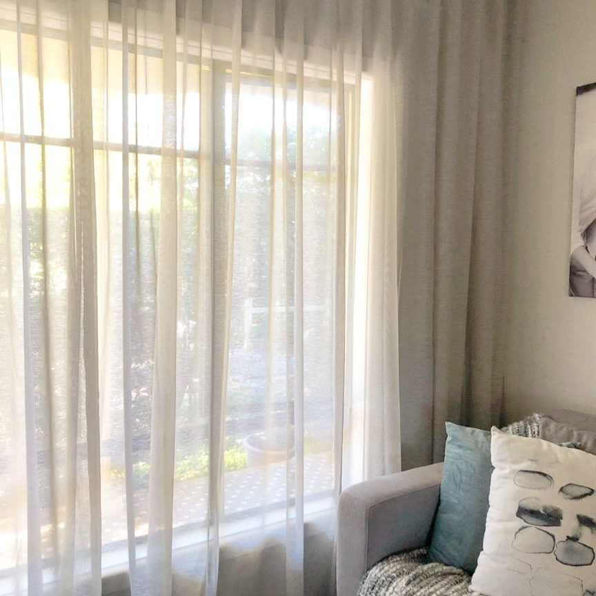 Sheer grey s-fold curtain